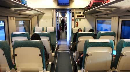 přihrádka : LA CORUNA, SPAIN - APRIL 1, 2018: Unknown passengers in the railway car of the high-speed train. Dostupné videozáznamy