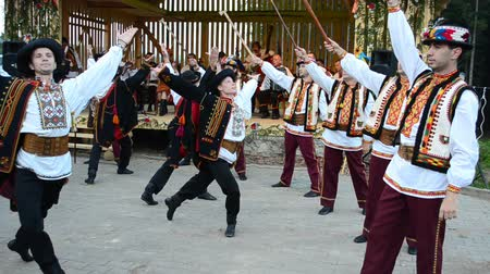 haft : YAREMCHE, UKRAINE - JULY 7: Dances of the people of mountains. Huzul national dances, Ukraine.