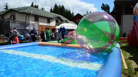 hydro : BUKOVEL, UKRAINE - JULY 12 2015: Childrens attraction, balloons. Water game, attraction.