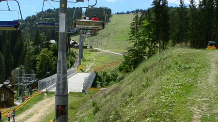 kladkostroj : BUKOVEL, UKRAINE - JULY 12 2015: Operation of the surface lift in the summer. Bukovel the largest ski resort of Ukraine, Ukraine on July 12, 2015