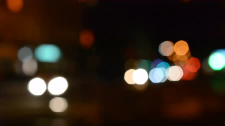 küresel : Traffic in the middle of the night. Out of focus.