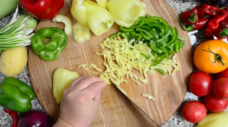 chili : The cook cuts pepper. Preparation of vegetables.