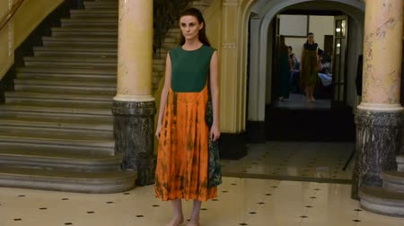 jelenleg : LVIV, UKRAINE - AUGUST 5, 2014: Week of fashion in Lviv. Fashion designers of Zhanna Volynets and Sergey Drachev.