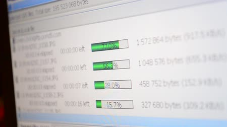 мультимедиа : Loading of files. The process file is uploading in the internet on a computer screen.