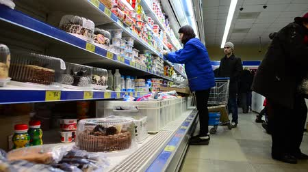 supermarket shelf : BERDYANSK, UKRAINE - APRIL 5, 2015: Choice of products, dairy products Stock Footage