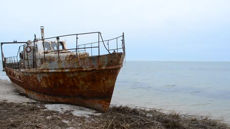 kaplanmış : Rusty fishing ship ashore.