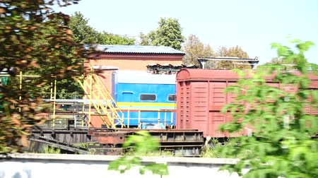 container terminal : The train arrives to the railway station. Shooting in the movement.