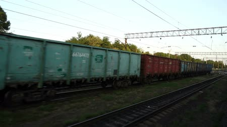 sağlamak : VINNITSA, UKRAINE - AUGUST 19, 2018: Cargo carriage of the railway train. Shooting in the movement. Stok Video