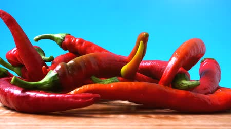 peperoni : Red chilli, pepper. Shooting in the movement. Shooting in kitchen.