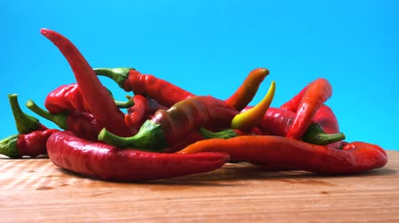 pepper : Red chilli, pepper. Shooting in the movement. Shooting in kitchen.