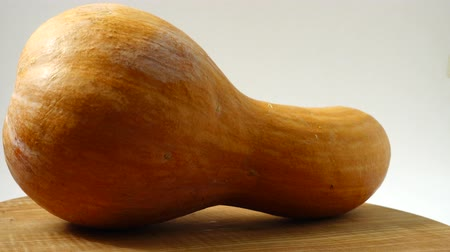 pumpkin pieces : Pumpkin on a kitchen board. Shooting in the movement. Stock Footage