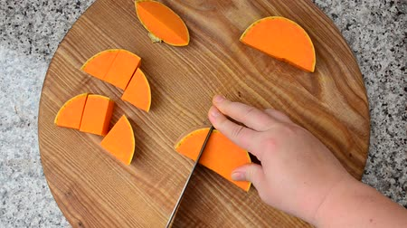 pumpkin pieces : Cutting of pumpkin. Work of the cook. Shooting in kitchen. Stock Footage