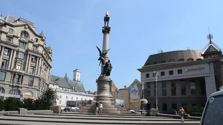 troli : LVIV, UKRAINE - JULY 5, 2014: Adam Mickiewicz Monument in Lviv, Ukraine. Mickiewicz (1798-1855) was a Polish national poet, essayist, translator, publicist and political writer. Stock mozgókép