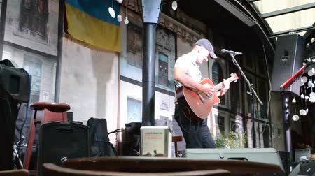 serseri : LVIV, UKRAINE - JULY 5, 2014: The scene and the musician, sings songs.