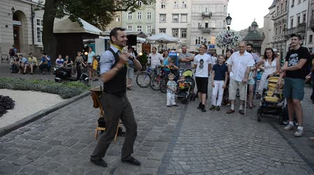 miraculous : LVIV, UKRAINE - JULY 5, 2014: The street conjurer.