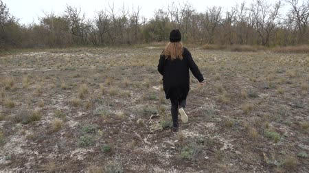 hair growth : The girl runs on a heathland. Slow motion. Shooting in the fall. Stock Footage