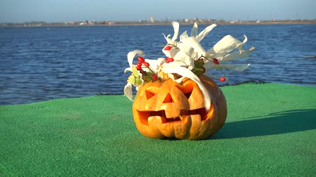 jack olantern : Spooky halloween pumpkin. Shooting against the background of the sea. Sea and waves. Shooting in October.