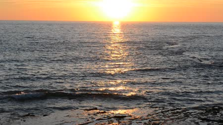 declínio : Sunset over the Atlantic Ocean. Chipiona, the city in Andalusia, Spain. Stock Footage