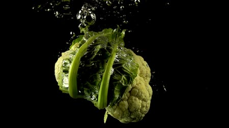 clear liquid : Falling of cauliflower in water. Slow motion.