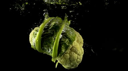 karnabahar : Falling of cauliflower in water. Slow motion.