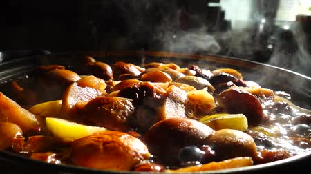 pears : Cooking stewed fruit. Slow motion. Compote cooks in a pan.