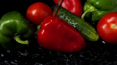 peper : Water flows on vegetables. Slow motion. Stock Footage