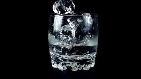 ice cube : The ice cubes falling in a glass. Slow motion.