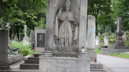 cassock : Grave of the priest. Lviv, Ukraine. Lychakovsky cemetery (polish. Cmentarz ?? yczakowski) ??? the historical and memorial memorial estate (since 1991), one of the oldest cemeteries of Ukraine.