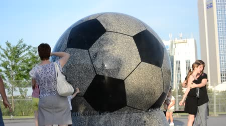 delirar : Stone football. Stone football. Donbass Arena modern football stadium in Donetsk, constructed in 2009, calculated on 50 thousand spectators.