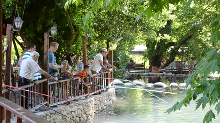 rúd : BELDIBI, TURKEY - JUNE 11: Trout fishing at the Belize Resort & Spa on June 11, 2012 in Beldibi, Turkey.