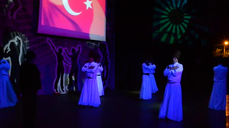 whirling : BELDIBI, TURKEY - JUNE 11: Performers of the Turkish Night show at the Turkiz Resort & Spa on June 11, 2012 in Beldibi, Turkey.