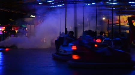 springkussen : Bumper cars, People driving through artificial smoke.