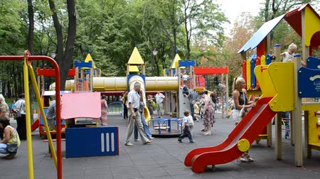 recess : Children play in the playground in the summer.
