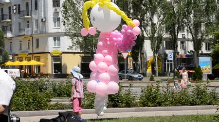 goma : little girl playing with balloons. The young fireman. A holiday Childrens day.