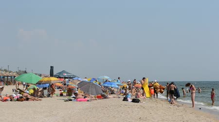 parasol : People on the sea beach.