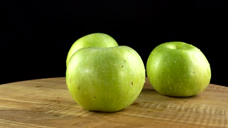 fruity garden : Apples on a black background. Cutting board in the movement. Stock Footage