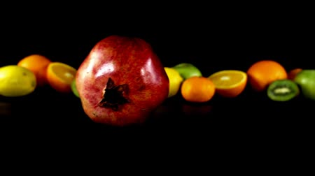 unpeeled : The sliding pomegranate against the background of fruit. Slow motion. Stock Footage