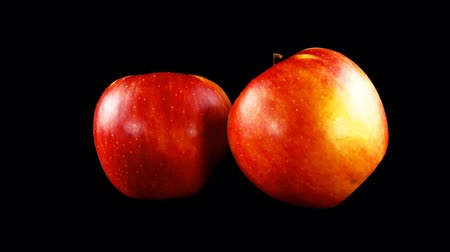 fruity garden : Apple on a black background. Stock Footage