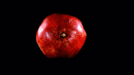 antioxydant : Pomegranate on a black background.