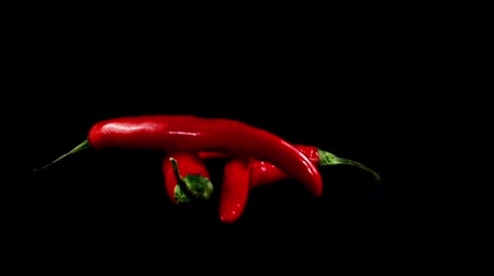 peperoni : Chili pepper on a black background. Shooting in the movement. Stock Footage