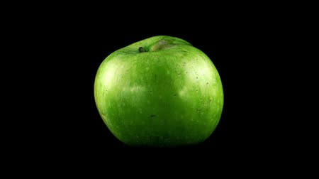 calorias : Apple on a black background. Shooting in the movement. Stock Footage