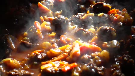 beef dishes : Frying pan. Slow motion.