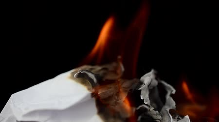 poder : Fire and smoke from paper on a black background. The burning paper