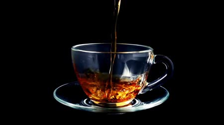 teacup : Tea is poured into the cup. Slow motion. Stock Footage