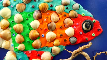 snag : The model of fish from plasticine and shells Stock Footage