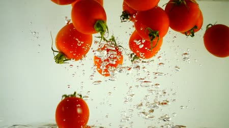 salad : Cherry tomatoes in water. Slow motion.