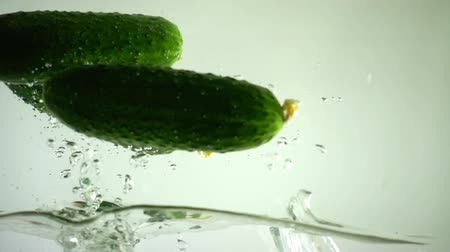 омоложение : Cucumbers in water. Slow motion.