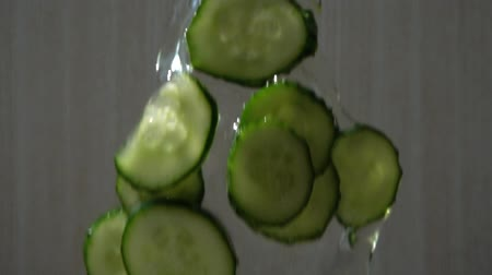 tápanyagok : The falling cucumber slices. Slow motion. Stock mozgókép