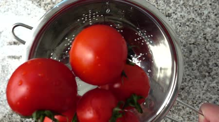 colander : Tossing of tomatoes in a colander. Drying of tomatoes from water. Slow motion. Stock Footage