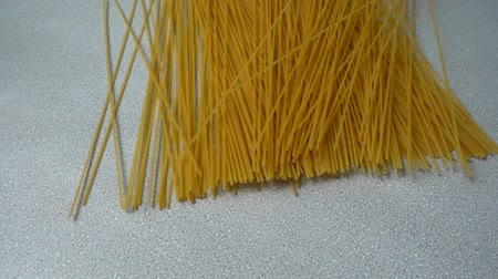 supermarket food : The falling spaghetti on a table. Slow motion.